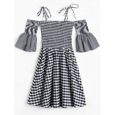 Cami Smocked Plaid DressWomens Dresses<br>Cami Smocked Plaid Dress<br><br>Dresses Length: Mini<br>Material: Polyester<br>Neckline: Spaghetti Strap<br>Occasion: Night Out<br>Package Contents: 1 x Dress<br>Pattern Type: Plaid<br>Season: Summer, Spring, Fall<br>Silhouette: A-Line<br>Sleeve Length: Half Sleeves<br>Sleeve Type: Flare Sleeve<br>Style: Cute<br>Weight: 0.2700kg<br>With Belt: No