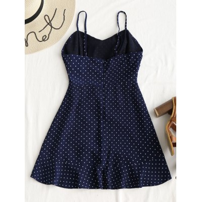 Polka Dot Cut Out Tie Mini DressMini Dresses<br>Polka Dot Cut Out Tie Mini Dress<br><br>Dresses Length: Mini<br>Material: Cotton, Polyester<br>Neckline: Spaghetti Strap<br>Occasion: Casual , Night Out, Going Out<br>Package Contents: 1 x Dress<br>Pattern Type: Polka Dot<br>Season: Summer<br>Sleeve Length: Sleeveless<br>Weight: 0.2600kg<br>With Belt: No