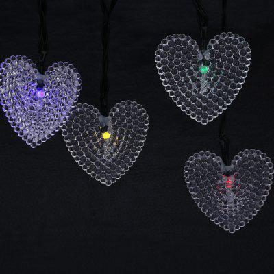 Solar Powered Waterproof 20 LEDs Love Heart String LightOutdoor Lights<br>Solar Powered Waterproof 20 LEDs Love Heart String Light<br><br>Is Bulbs Included: Yes<br>Is Dimmable: No<br>Light Source: LED Bulbs<br>Package Contents: 1 x String Lamp with Solar Panel, 1 x Anchor Spike, 1 x English Manual<br>Package Size(L x W x H): 18.50 x 10.00 x 8.50 cm / 7.28 x 3.94 x 3.35 inches<br>Package weight: 0.4140 kg<br>Product weight: 0.3210 kg<br>Style: Modern, Art Deco, Tiffany