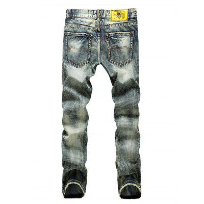Ripped Slim Fit Tapered Leg JeansMens Pants<br>Ripped Slim Fit Tapered Leg Jeans<br><br>Material: Cotton<br>Package Contents: 1 x Men Pants<br>Package size: 35.00 x 25.00 x 2.00 cm / 13.78 x 9.84 x 0.79 inches<br>Package weight: 0.5000 kg<br>Product weight: 0.4300 kg