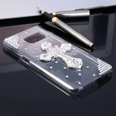 Practical Phone Back Case Protector for Samsung Galaxy S7Samsung S Series<br>Practical Phone Back Case Protector for Samsung Galaxy S7<br><br>Color: Transparent<br>Features: Anti-knock, Jewel Covered Cases, Back Cover<br>Material: PC<br>Package Contents: 1 x Case<br>Package size (L x W x H): 21.00 x 12.00 x 2.00 cm / 8.27 x 4.72 x 0.79 inches<br>Package weight: 0.057 kg<br>Product size (L x W x H): 14.30 x 7.30 x 0.90 cm / 5.63 x 2.87 x 0.35 inches<br>Product weight: 0.025 kg<br>Style: Diamond Look, Transparent