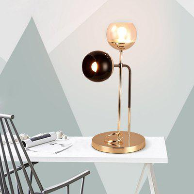 Lanshi D - 8116 Modern Metal Table Lamp E12Table Lamps<br>Lanshi D - 8116 Modern Metal Table Lamp E12<br><br>Brand: Lanshi<br>Bulb Included: No<br>Certifications: CE,FCC<br>Decoration Material: Glass,Metal<br>Electric Products: Supporting Electrical Products<br>Features: Ambient Lamps, Creative, Novelty<br>Finish (??????????): Black,Gold<br>Fixture Material: Glass,Metal<br>Light Direction: Ambient Light<br>Overall Height ( CM ): 58<br>Overall Length ( CM ): 28<br>Overall Width ( CM ): 28<br>Package Contents: 1 ? Table Lamp, 1 ? Installation Instruction<br>Package size (L x W x H): 62.00 x 32.00 x 32.00 cm / 24.41 x 12.6 x 12.6 inches<br>Package weight: 3.2000 kg<br>Power Supply: Power Plug<br>Product size (L x W x H): 28.00 x 28.00 x 58.00 cm / 11.02 x 11.02 x 22.83 inches<br>Product weight: 2.8000 kg<br>Production Models: Self-produce<br>Shade Material: Glass<br>Style: Artistic Style, Chic/Modern, Metallic, Modern Style<br>Switch Type: On or Off Switch<br>Type: Desk Lamp<br>Voltage ( V ): 110V - 220V<br>Wattage: 80<br>Wattage per Bulb ( W ): 40