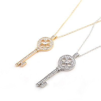 European and American Diamond Pierced Key Necklace Four-Leaf Grass Pendant Sweater ChainNecklaces &amp; Pendants<br>European and American Diamond Pierced Key Necklace Four-Leaf Grass Pendant Sweater Chain<br><br>Gender: For Women<br>Item Type: Chains Necklaces<br>Material: Semi-Precious Stone<br>Metal Type: Zinc Alloy<br>Necklace Type: Link Chain<br>Package Contents: 1 x necklace<br>Package size (L x W x H): 1.00 x 1.00 x 1.00 cm / 0.39 x 0.39 x 0.39 inches<br>Package weight: 0.0100 kg<br>Product size (L x W x H): 1.00 x 1.00 x 1.00 cm / 0.39 x 0.39 x 0.39 inches<br>Shape/Pattern: Key<br>Stone Color: White<br>Style: Classic<br>Surface Plating: Silver Plated