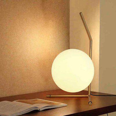 TD-8319 Table Light E27 AC 220VTable Lamps<br>TD-8319 Table Light E27 AC 220V<br><br>Bulb Base: E27<br>Bulb Included: No<br>Certifications: CE,RoHs<br>Features: Eye Protection<br>Fixture Material: Glass,Metal<br>Overall Height ( CM ): 15CM<br>Overall Length ( CM ): 20CM<br>Overall Width ( CM ): 20CM<br>Package Contents: 1 x  Table Lamp, 1  x  English User Manual<br>Package size (L x W x H): 25.00 x 25.00 x 20.00 cm / 9.84 x 9.84 x 7.87 inches<br>Package weight: 2.0000 kg<br>Power Supply: Power Plug<br>Product size (L x W x H): 20.00 x 20.00 x 15.00 cm / 7.87 x 7.87 x 5.91 inches<br>Product weight: 1.5000 kg<br>Shade Material: Glass<br>Style: Modern Style<br>Switch Type: On Off Switch<br>Type: Desk Lamp<br>Voltage ( V ): AC220<br>Wattage: 60W