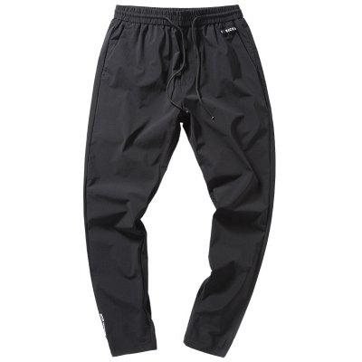 Men's Ribbons Decorated Feet Nine Points Sports Casual Pants