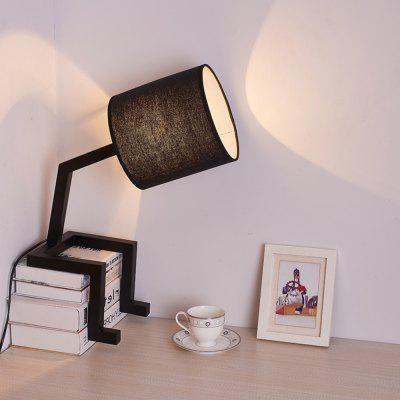 TD8306-TG E27 Table Lamp 40X20X53CMTable Lamps<br>TD8306-TG E27 Table Lamp 40X20X53CM<br><br>Bulb Base: E27<br>Bulb Included: No<br>Certifications: CE,RoHs<br>Color Temperature or Wavelength: 2800K<br>Features: Eye Protection<br>Fixture Material: Metal<br>Overall Height ( CM ): 53CM<br>Overall Length ( CM ): 40CM<br>Overall Width ( CM ): 20CM<br>Package Contents: 1 x Table Light, 1  x  English User Manual<br>Package size (L x W x H): 57.00 x 27.00 x 24.00 cm / 22.44 x 10.63 x 9.45 inches<br>Package weight: 3.8000 kg<br>Power Supply: Power Plug<br>Product size (L x W x H): 40.00 x 20.00 x 53.00 cm / 15.75 x 7.87 x 20.87 inches<br>Product weight: 3.0000 kg<br>Shade Material: Cloth<br>Style: Modern Style<br>Switch Type: Dimmer<br>Type: Desk Lamp<br>Voltage ( V ): AC220<br>Wattage: 60W