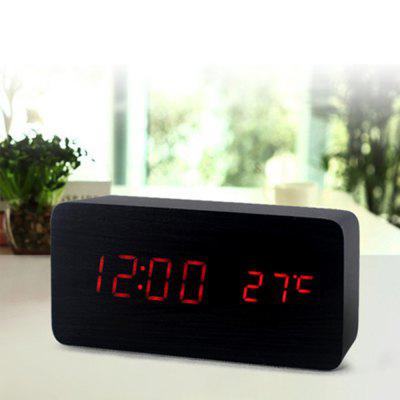 New Voice-activated LED Creative Home Bedside Wooden Luminous Electronic Alarm ClockHome Gadgets<br>New Voice-activated LED Creative Home Bedside Wooden Luminous Electronic Alarm Clock<br><br>Materials: Wood<br>Package Contents: 1 x Alarm Clock<br>Package Size(L x W x H): 17.00 x 5.00 x 9.00 cm / 6.69 x 1.97 x 3.54 inches<br>Package weight: 0.3000 kg