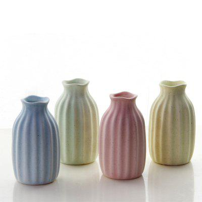 Four Color Available Ceramic Flower Vases For Tabletop Mini VaseCrafts<br>Four Color Available Ceramic Flower Vases For Tabletop Mini Vase<br><br>Color: Pink,Green,Yellow,Light blue<br>For: Parents, Sisters, Lovers<br>Material: Ceramic<br>Package Contents: 1x Vase<br>Package weight: 0.1700 kg<br>Product size (L x W x H): 4.70 x 4.70 x 10.00 cm / 1.85 x 1.85 x 3.94 inches<br>Product weight: 0.1600 kg<br>Subjects: Fashion,Cute,Abstract<br>Usage: Wedding, Birthday, New Year