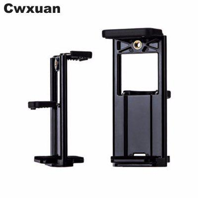 Cwxuan 2 in 1 Universal Tablet PC and Phone Mount Holder Tripod AdapterStands &amp; Holders<br>Cwxuan 2 in 1 Universal Tablet PC and Phone Mount Holder Tripod Adapter<br><br>Color: Black<br>Material: Plastic<br>Package Contents: 1 x 2 in 1 Tripod Clip<br>Package size (L x W x H): 12.70 x 5.50 x 6.20 cm / 5 x 2.17 x 2.44 inches<br>Package weight: 0.0630 kg<br>Product size (L x W x H): 12.50 x 5.20 x 6.00 cm / 4.92 x 2.05 x 2.36 inches<br>Product weight: 0.0600 kg<br>Type: Clip Stand