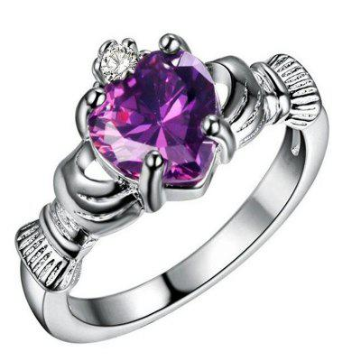 Holding Heart Shaped Color Gemstone Crystal Ring